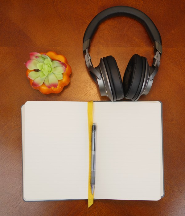 Flat lay photo of Audio Technica headphones with a succulent and notepad. 3 Reasons Musical Gifts Make Dads Happy - Theresa's Reviews