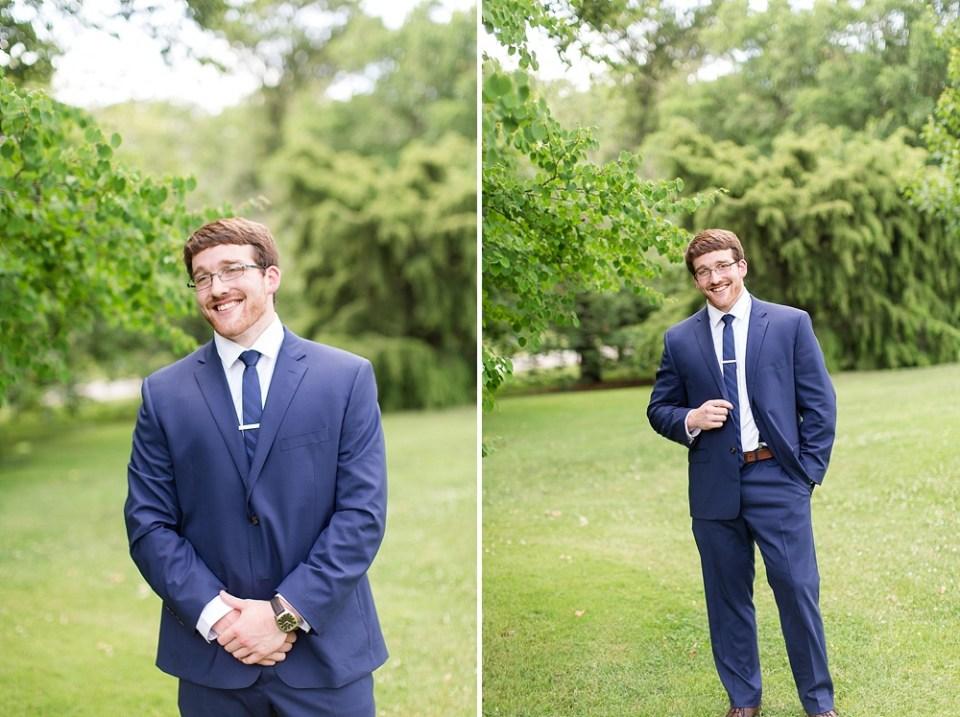 groom posing in park