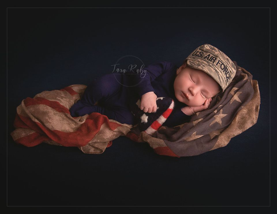 newborn photo with camo and American flag