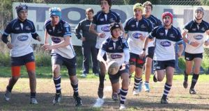 U16 - Captain Tomas Munilla surrounded by his team