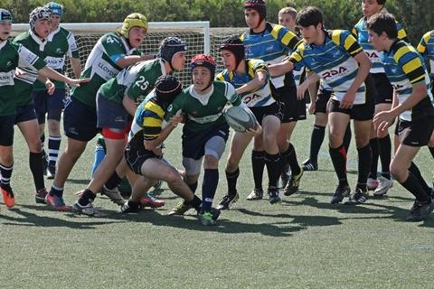 U16 Carlos Martin surrounded by both teams