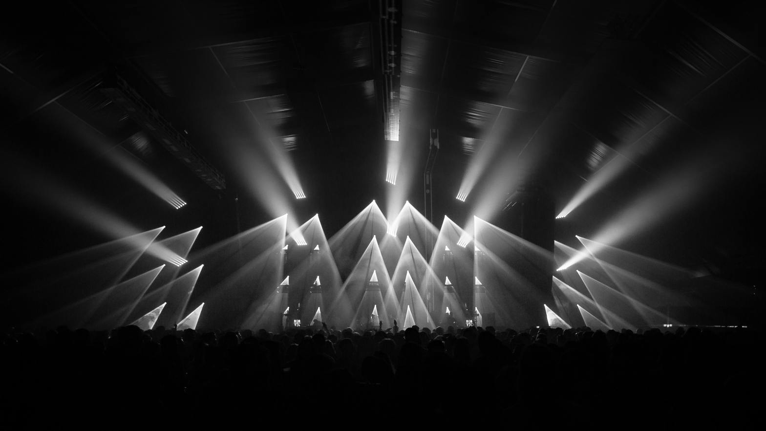grayscale photo of stage with lights