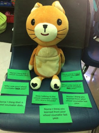 Using a stuffed animal I call Felix the Feeling Cat to review the role of school counselors and how students can self refer.