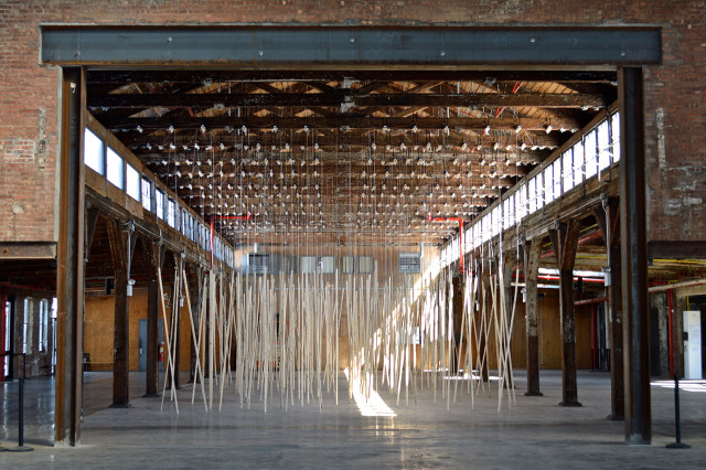 Zimoun, 250 prepared ac-motors, 325 kg roof laths, 1.8 km rope, 2015, installation view at Knockdown Center, Maspeth, NY. Photo: by author for Hyperallergic.
