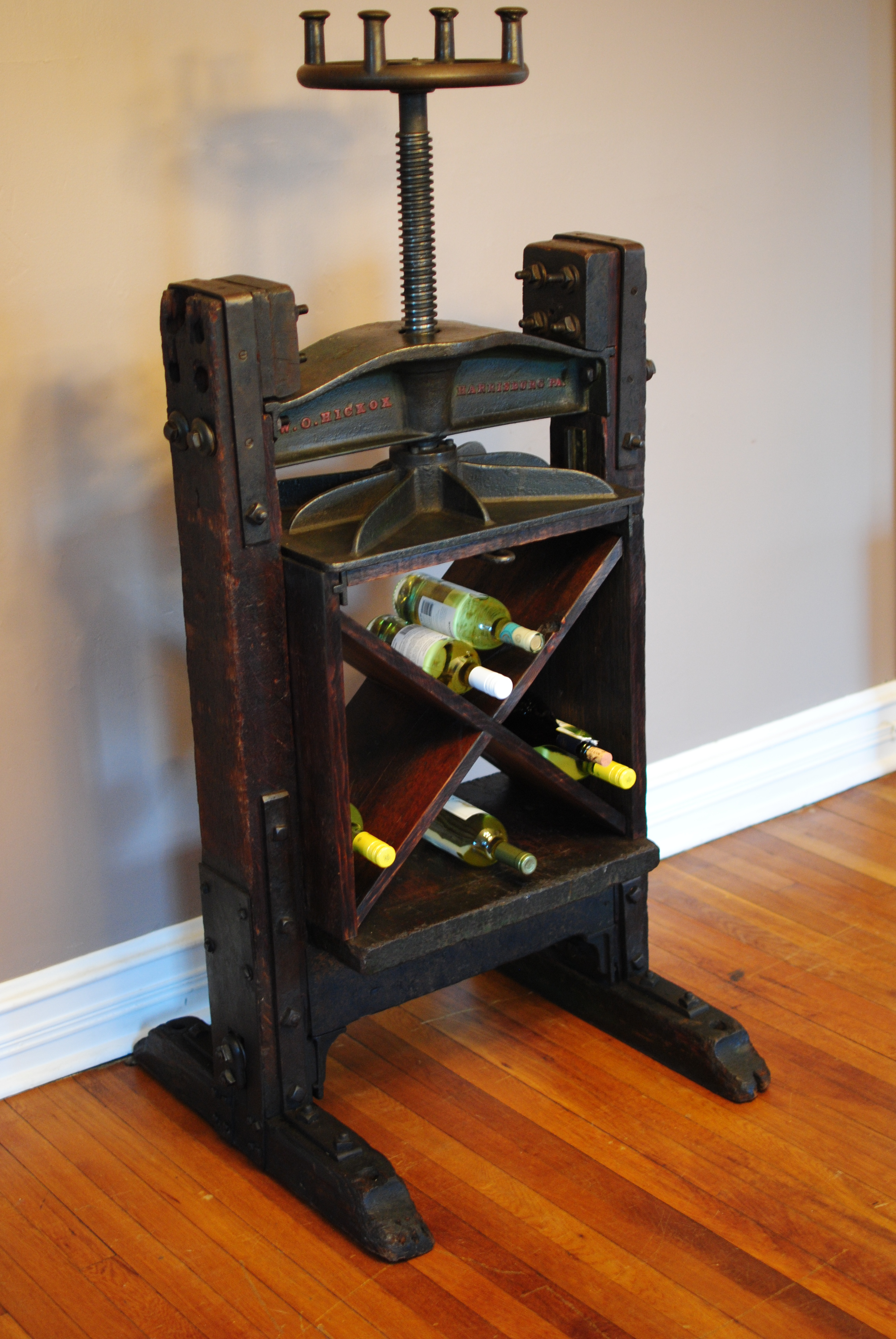 An 1860s Book Press repurposed into winebar storage and
