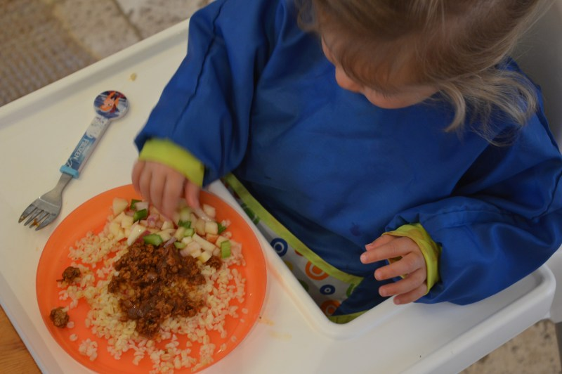 Toddler eating Gousto food in a highchair