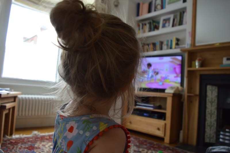 Little girl watching DisneyLife on TV