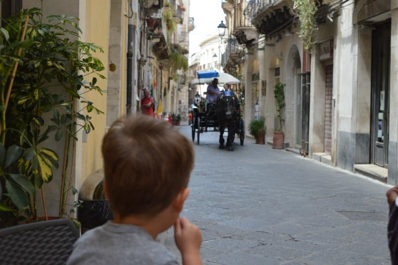 A horse-drawn carriage in Ortigia