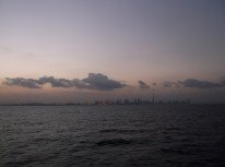 Sjarjah's & Dubai's skyline as seen from the ferry on the Persian Gulf