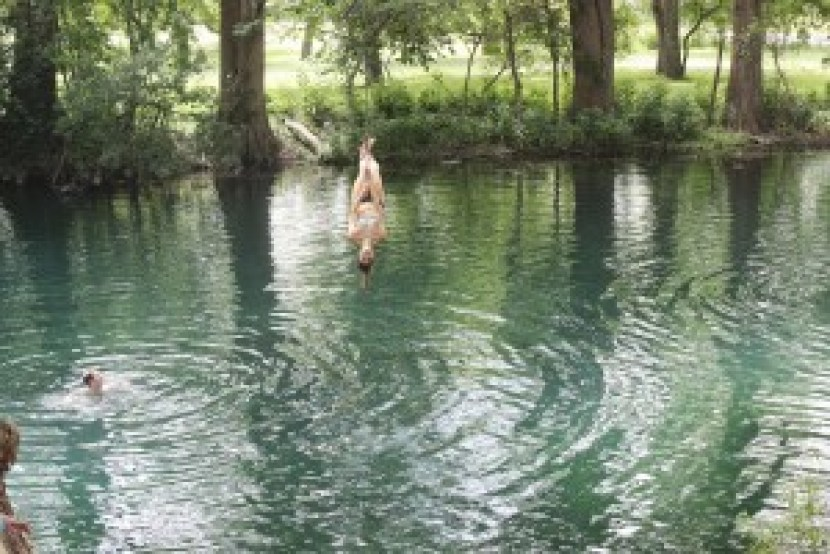 Ali, my sister-in-law, jumping from the rope swing into the Frio Springs