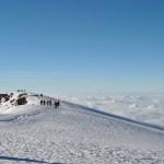 stages of excitement to elation: uhuru peak, kilimanjaro