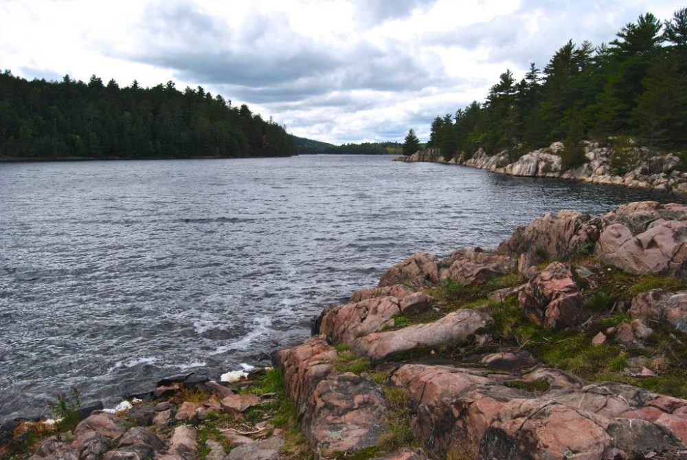 4 day canoe trip in Killarney provincial park - storm clouds and granite rock