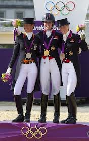 Gold Medal Dressage Team. Charlotte in the middle