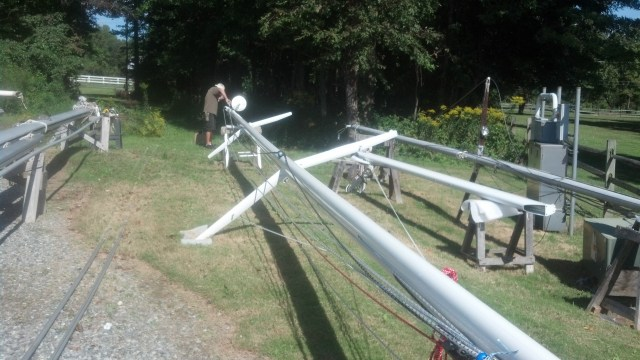 Sean Simmons Working Hard to Get the Mast Ready to Step