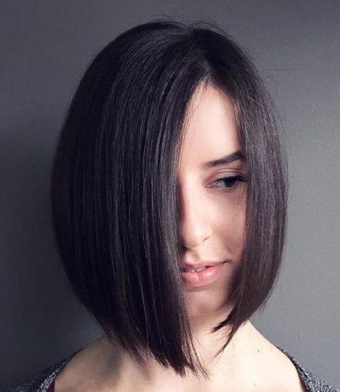 asymmetrical angled brunette bob