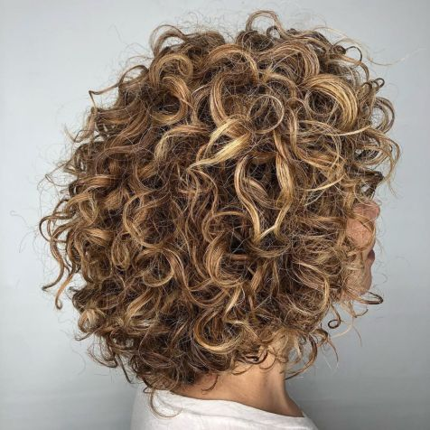 Medium Tousled Curly Caramel Hairstyle