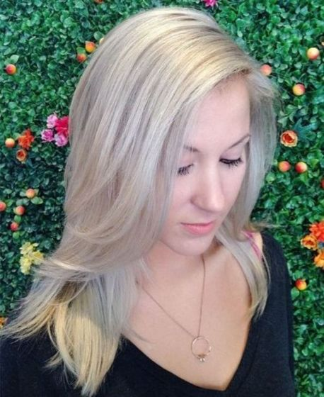 medium layered ash blonde hairstyle