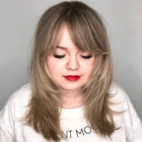 Medium Layered Hairstyle For Round Faces