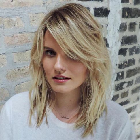 Mid-Length Wavy Hairstyle With Long Side Bangs