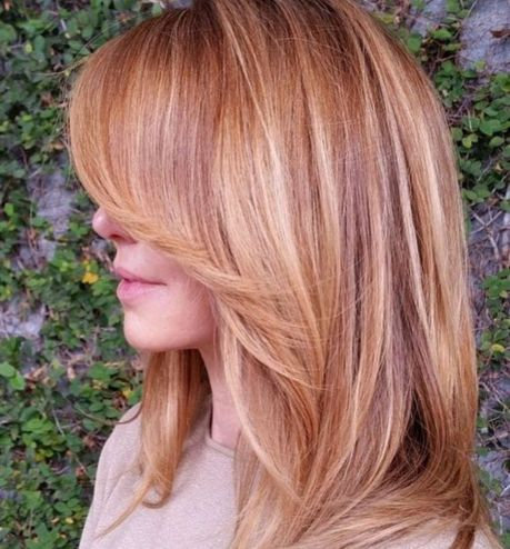 layered strawberry blonde hair with highlights