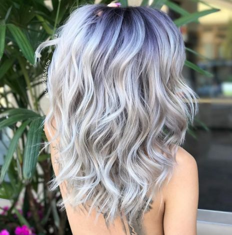 Ash Blonde Wavy Hairstyle With Blue Black Roots