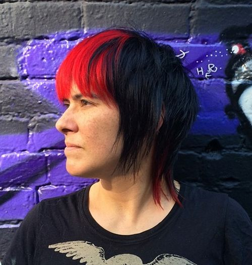 short black layered haircut with red bangs
