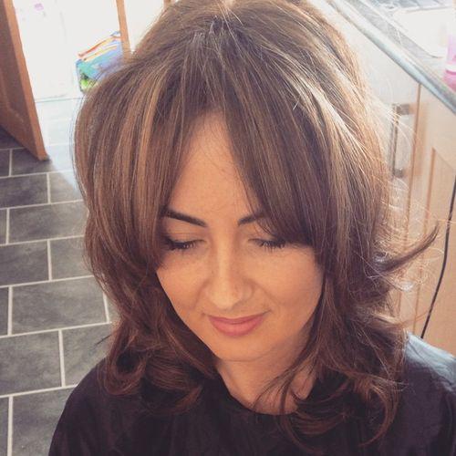 layered haircut with long bangs