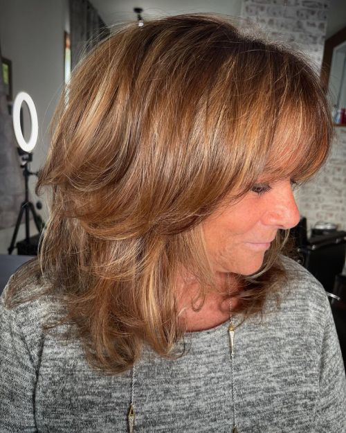 Voluminous Layered Hairstyle for an Older Woman