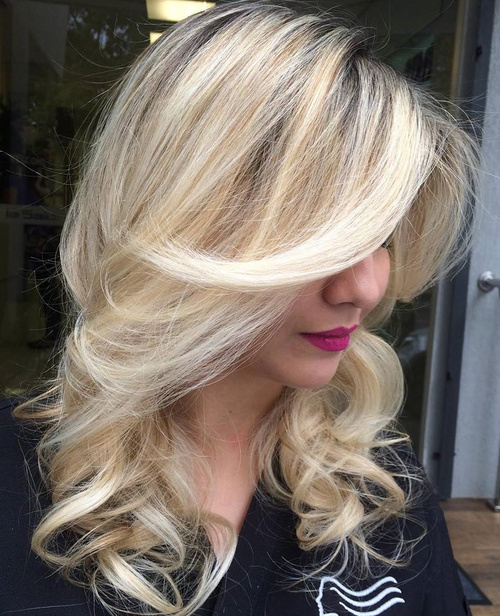 Blonde Curly Layered Hairstyle