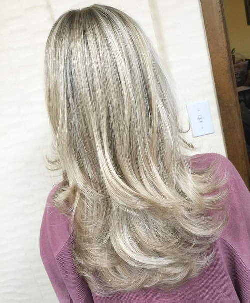 long blonde haircut with long layers