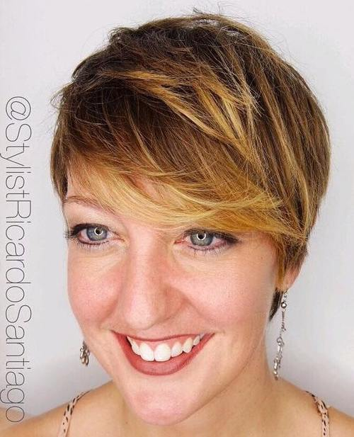 short sassy brown pixie with golden blonde balayage highlights