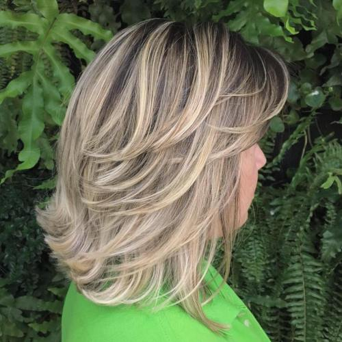 Mid-Length Feathered Ash Blonde Hairstyle