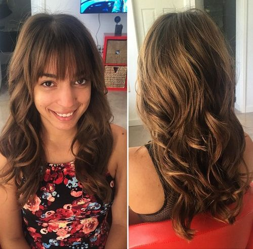 wavy layered hairstyle with bangs for long hair