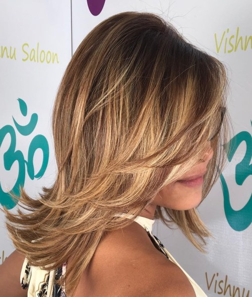 Mid Length Layered Hairstyle With Flicks