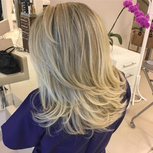 Mid-Length-To-Long Layered Ash Blonde Cut