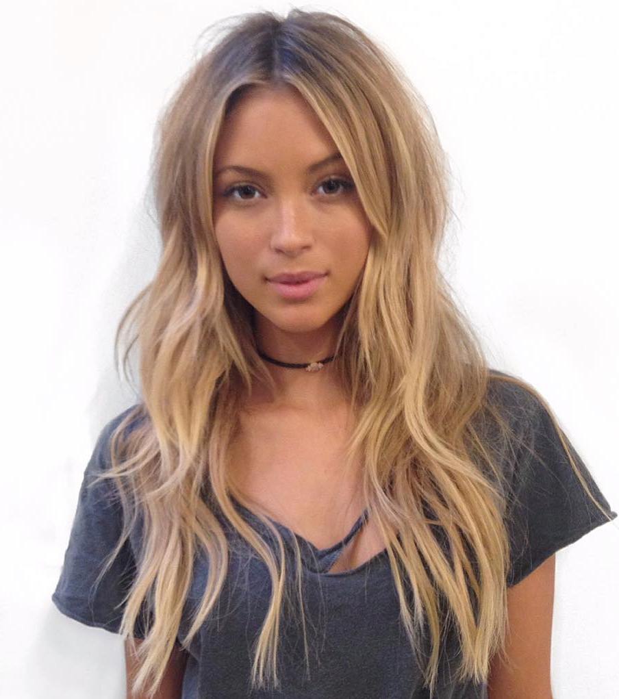 Layered Centre Part Hairstyle For Long Hair
