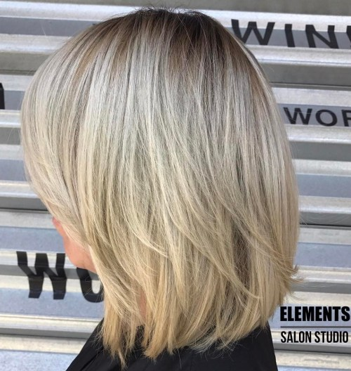 Blonde Layered Bob With Stretched Roots