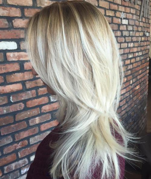 Blonde Layered Hair With Root Fade