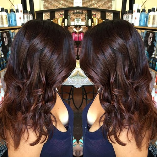 medium wavy chocolate brown hairstyle