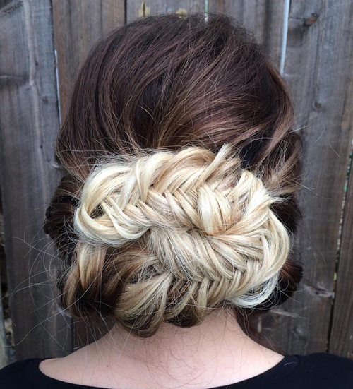 messy fishtail updo for long thick hair