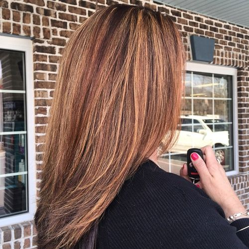 medium straight brown hair with caramel highlights