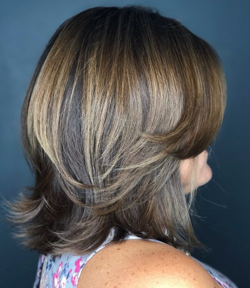 Medium Feathered Cut With Swoopy Bangs