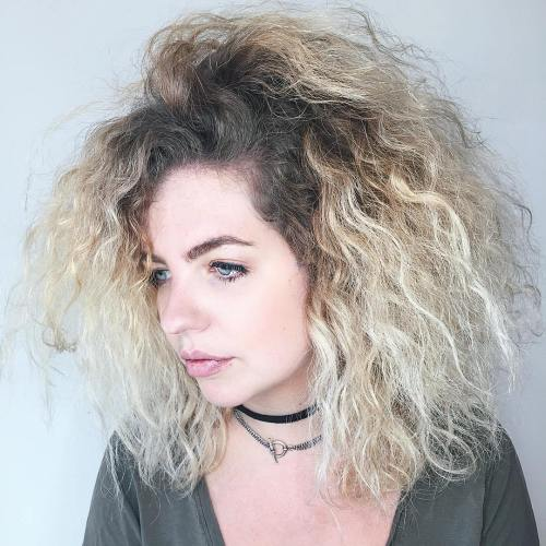 Medium Voluminous Curly Hairstyle