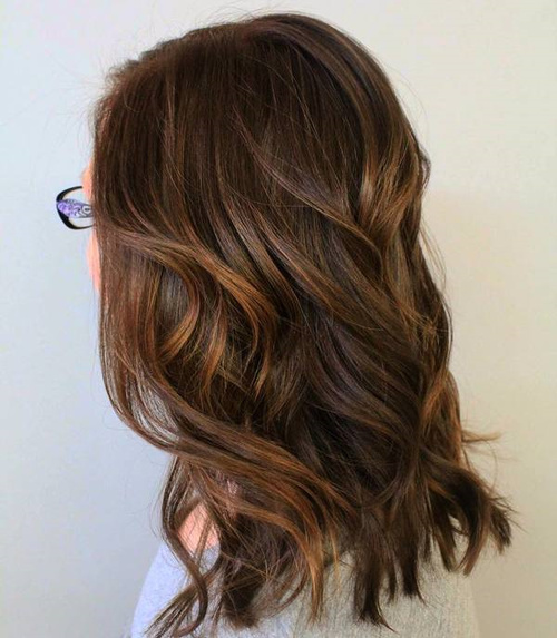 Medium Layered Brown Hair With Subtle Highlights