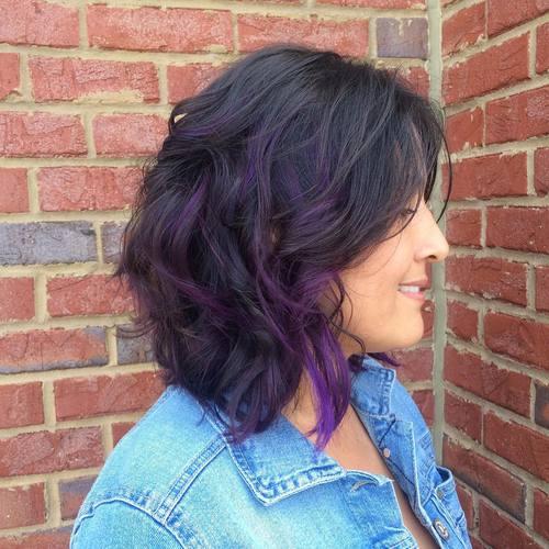 medium length black hairstyle with purple highlights