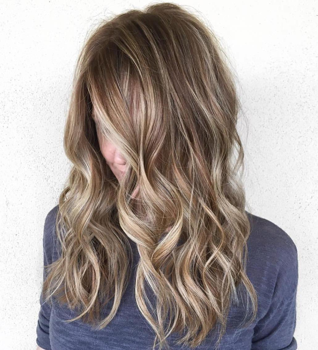 Wavy Brown Hair With Highlights