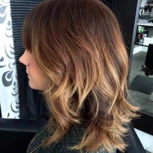 Medium Shag Haircut With Bangs