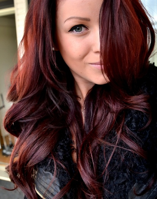 dark brown burgundy hair with highlights