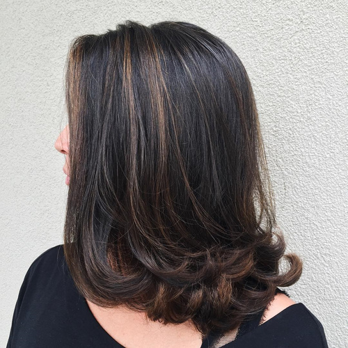 medium brunette hairstyle with flicks