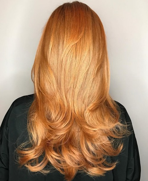Long Strawberry Blonde Hairstyle With Layers